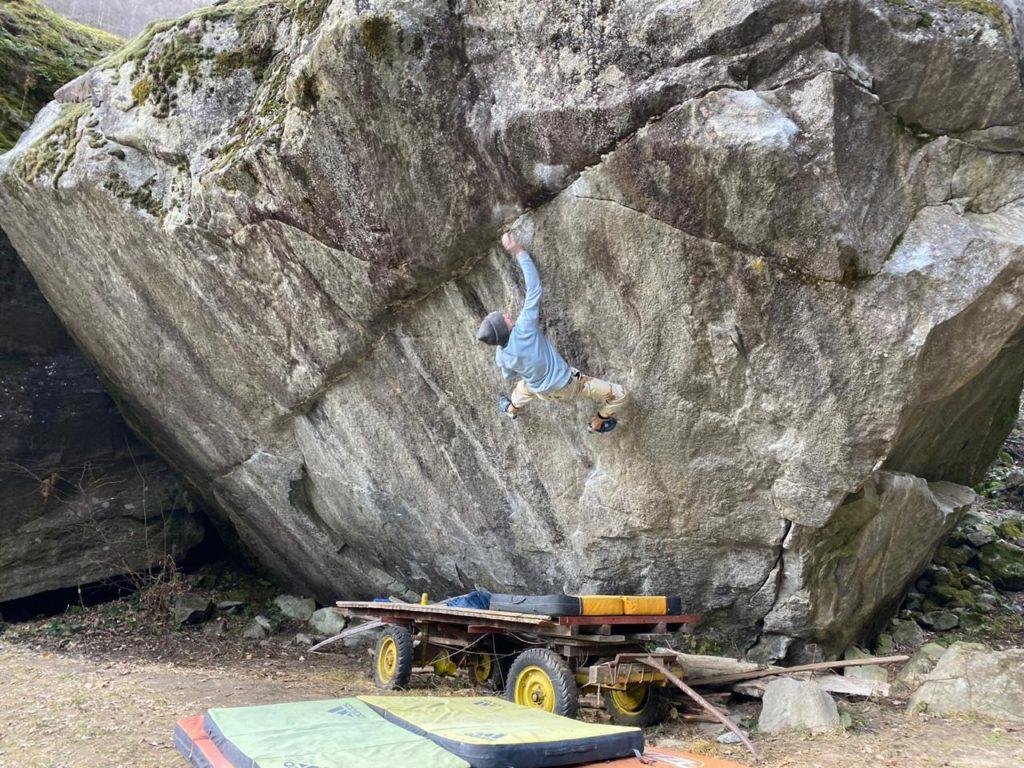 Vadim Timonov climbs Off the Wagon (8B+/V14), Val Bavona, Switzerland. He sent the bloc on his second go. Photo: Vadim Timonov.