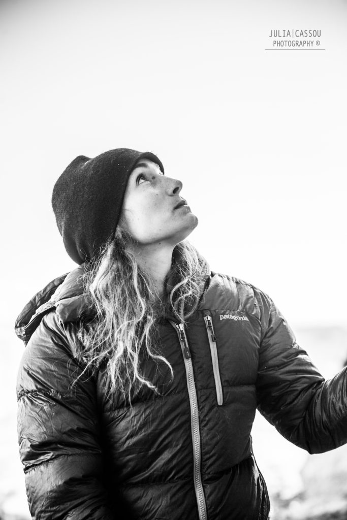Alpinist Lise Billon rock climbing.